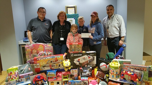 For the ninth year in a row, the Acacia team at our headquarters in Maynard did its part to make the holidays a little brighter for membersof our community. The team collected more than 60 toys and gifts as part of the Maynard Police Department's Toys for Kids drive!